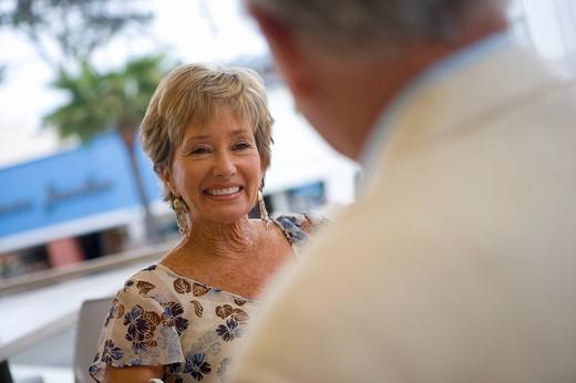 Senior woman smiling at man : Stock Photo