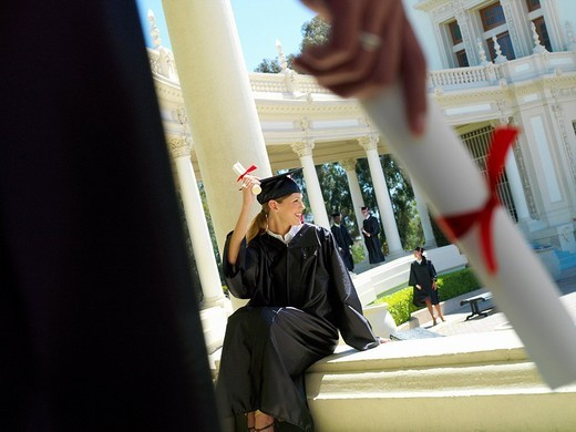 Female graduate on campus, close-up of hand : Stock Photo
