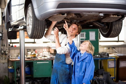 Stock Photo: 4208R-14775 Father and son working on car