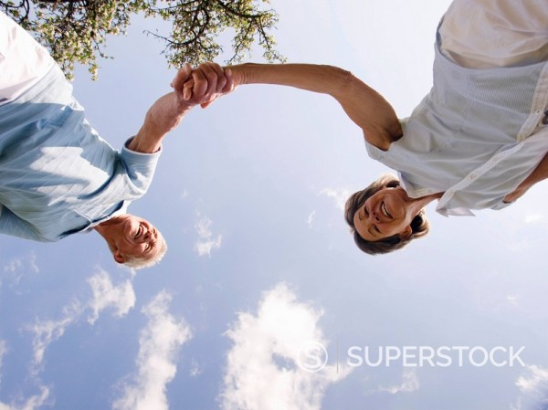 Stock Photo: 4208R-14801 Senior couple holding hands