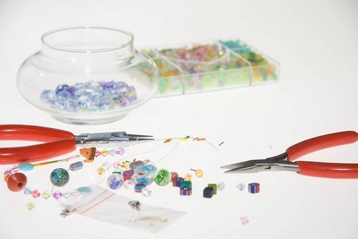 Colored beads and tools for making jewelry : Stock Photo