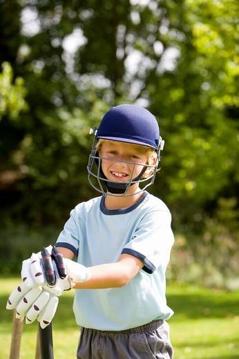 Boy 10-12 playing cricket, smiling, portrait : Stock Photo