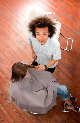 Hairdresser with client, portrait, elevated view : Stock Photo