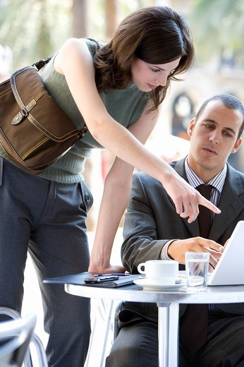 Businessman and businesswoman working in cafe : Stock Photo