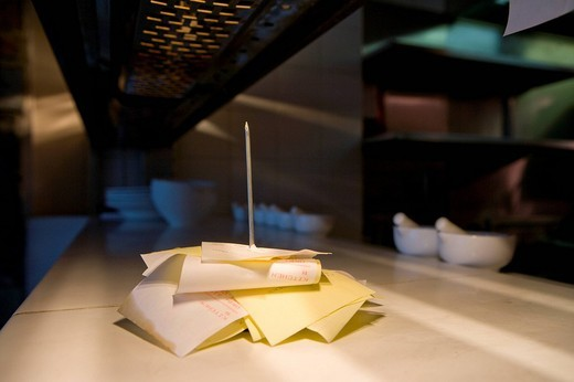 Stock Photo: 4208R-19243 Restaurant receipts stacked on spike