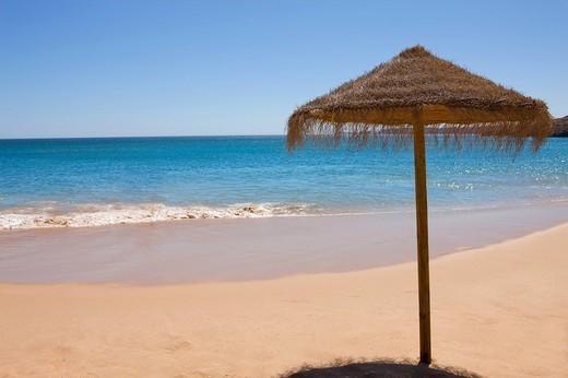 Stock Photo: 4208R-19285 Beach umbrella on tropical beach