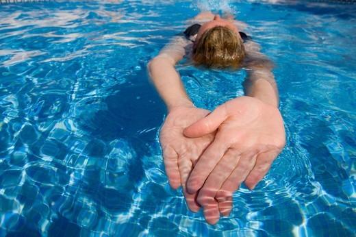 Stock Photo: 4208R-19292 Woman swimming in swimming pool