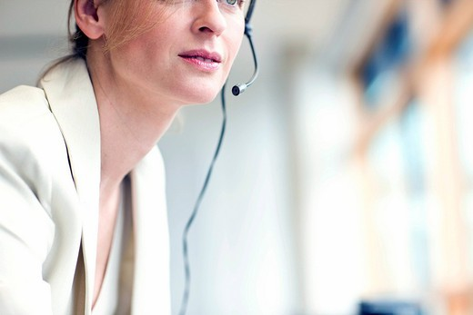 Cropped portrait of mature woman wearing headset : Stock Photo