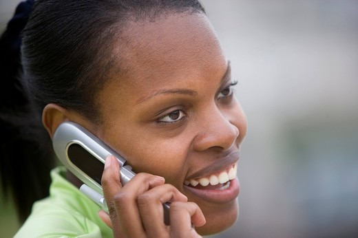 Stock Photo: 4208R-20595 Close up of African woman talking on cell phone