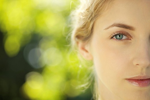 Close_up of young woman outdoors : Stock Photo