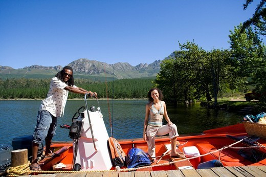Couple boating on lake : Stock Photo