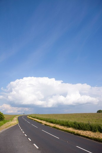 Clouds in blue sky over countryside road : Stock Photo