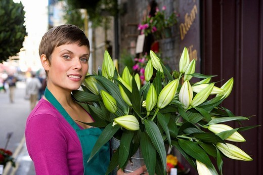 Stock Photo: 4208R-23762 Female florist with bunch of flowers, smiling, portrait