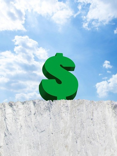 Dollar sign on edge of cliff : Stock Photo