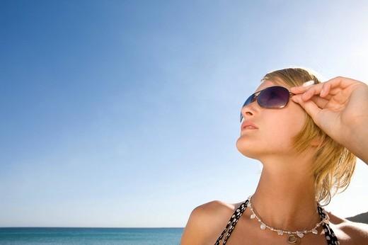 Stylish teenage girl posing on beach : Stock Photo