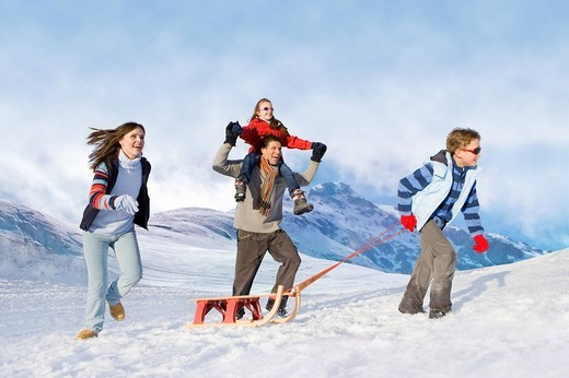 Stock Photo: 4208R-24719 Family pulling sled in snow