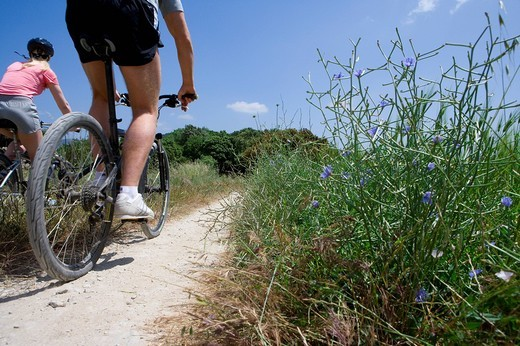 Stock Photo: 4208R-25197 Couple riding bicycles on rural path