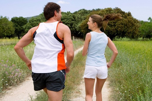 Couple running on rural path : Stock Photo