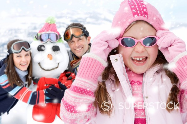 Portrait of family with snowman : Stock Photo