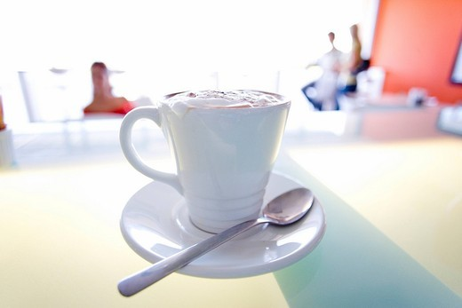 Cappuccino on bench in cafe : Stock Photo