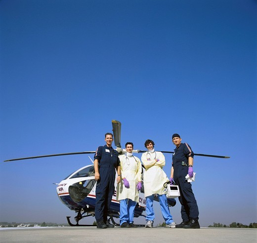 Portrait of doctors and paramedics outside emergency airlift helicopter : Stock Photo