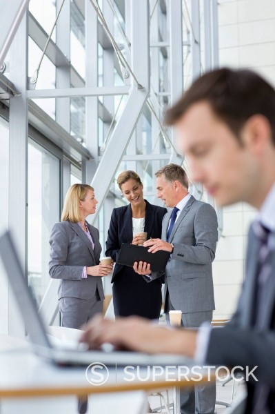 Business people meeting in lobby : Stock Photo