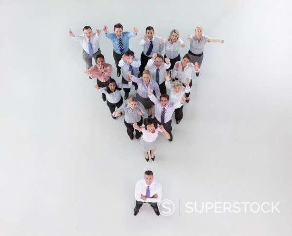 Stock Photo: 4208R-29380 Portrait of gesturing business people forming pyramid with boss in front