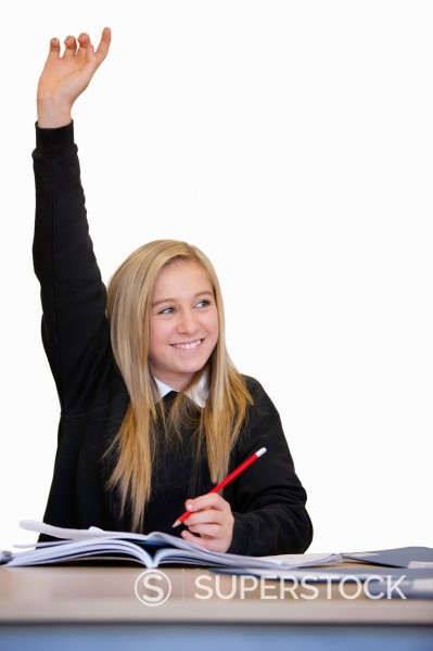 Stock Photo: 4208R-29732 Cut Out Of Female School Pupil Answering Question In Class