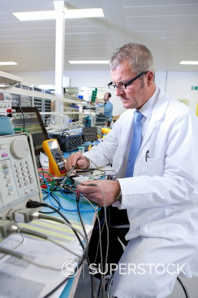 Stock Photo: 4208R-30018 Engineer working at electrical test bench
