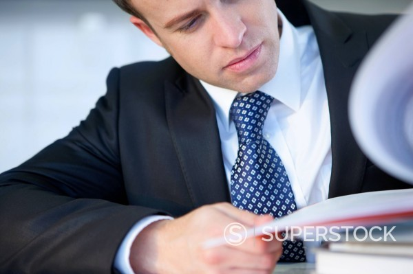 Close up of businessman reviewing report : Stock Photo