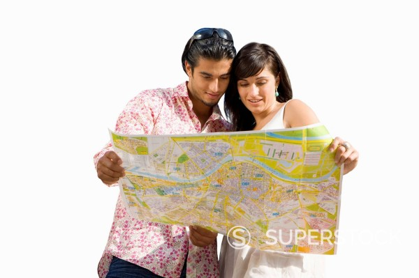 Cut Out Of Couple On Holiday Looking At Map : Stock Photo