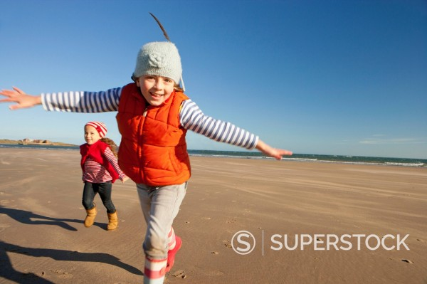 Stock Photo: 4208R-31190 Portrait of smiling girls running on sunny beach