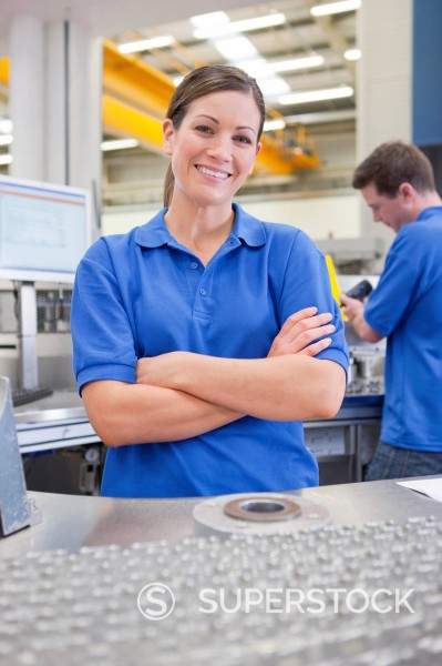 Stock Photo: 4208R-31795 Portrait of smiling technician with aluminum products in hi_tech manufacturing plant