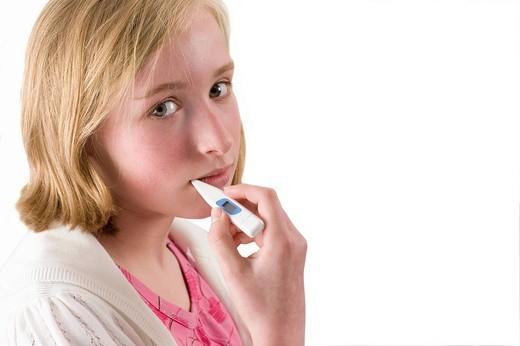 Stock Photo: 4208R-3633 Sick girl taking temperature with digital thermometer