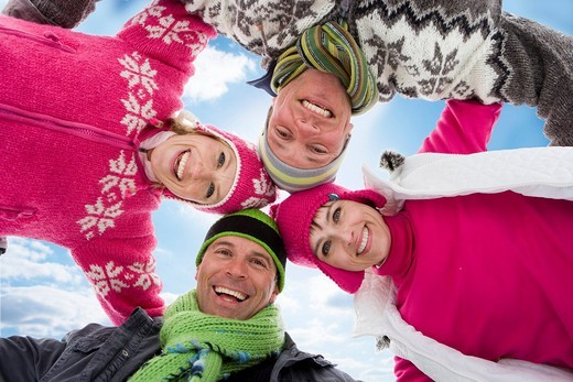 Smiling family hugging in circle together : Stock Photo