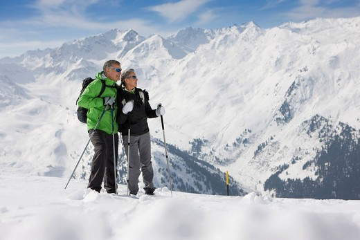 Couple hiking up ski slope on mountain : Stock Photo