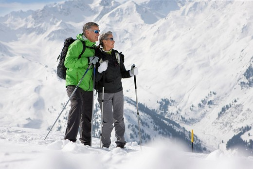 Couple hiking up ski slope on mountain : Stock Photo