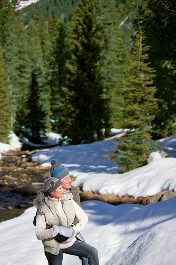 Stock Photo: 4208R-7498 Smiling couple exploring snow covered wilderness