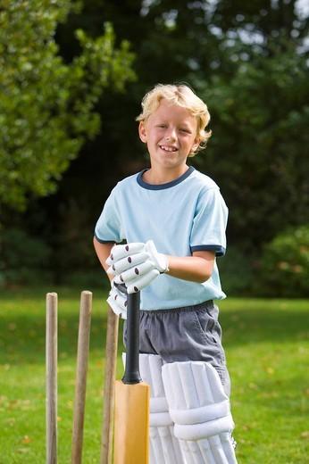 Boy 6-8 playing cricket, smiling, portrait : Stock Photo