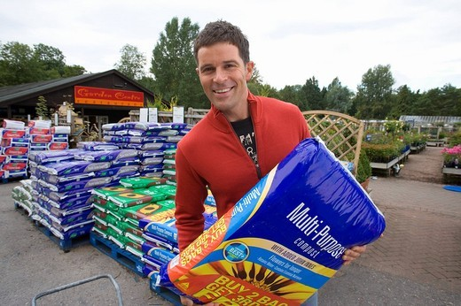Stock Photo: 4208R-8892 Man with bag of compost, smiling, portrait