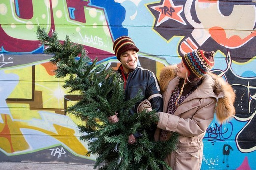 Couple buying Christmas tree : Stock Photo
