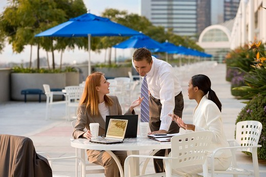 Businesspeople working at outdoor cafe : Stock Photo