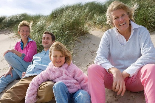 Stock Photo: 4208R-9171 Portrait of family relaxing on beach
