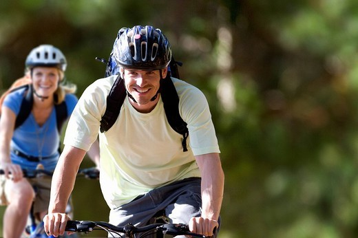 Stock Photo: 4208R-9258 Couple riding bicycles