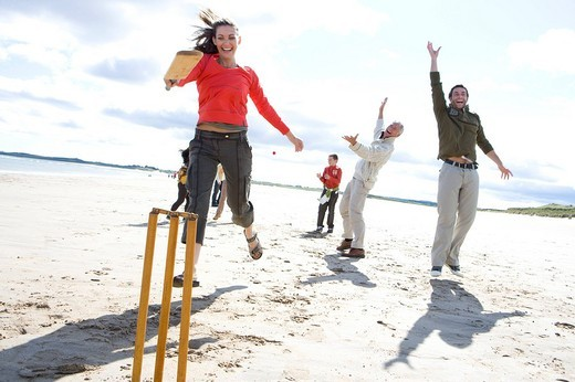 Stock Photo: 4208R-9582 Family playing cricket on beach
