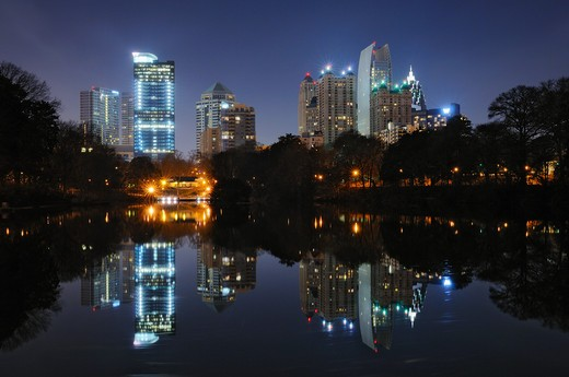 Stock Photo: 4209-127 Buildings lit up at the waterfront, Piedmont Park, Atlanta, Georgia, USA