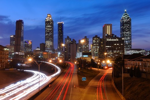 Stock Photo: 4209-128 High angle view of traffic with buildings lit up at dusk, Atlanta, Georgia, USA