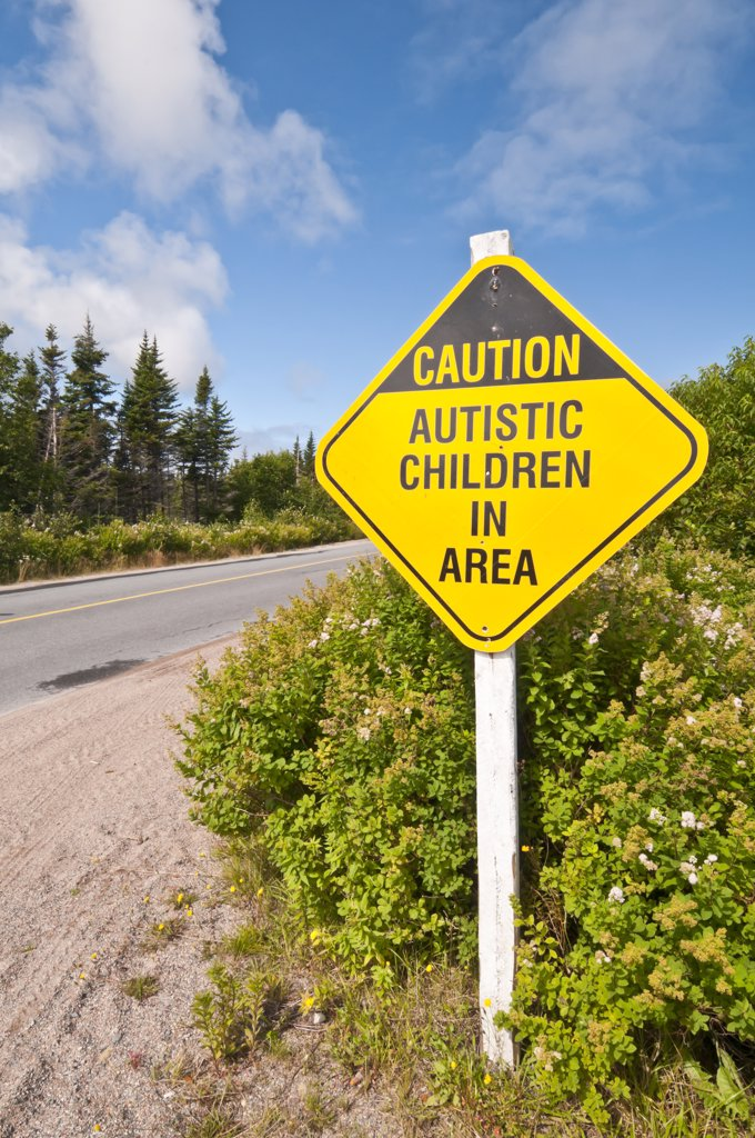 Warning sign reading the message 'Caution Autistic Children in Area', Elliston, Bonavista Peninsula, Newfoundland and Labrador, Canada : Stock Photo