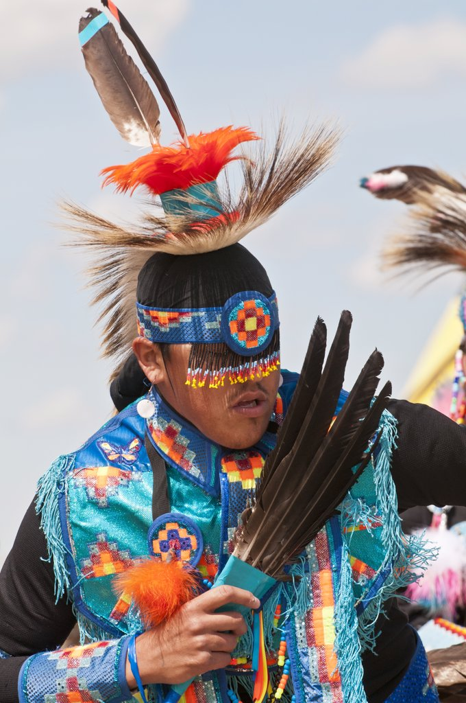 Stock Photo: 4215-321 Young male dancer in traditional regalia in 2nd Annual World Chicken Dance Championships, Blackfoot Crossing Historical Park, Alberta, Canada