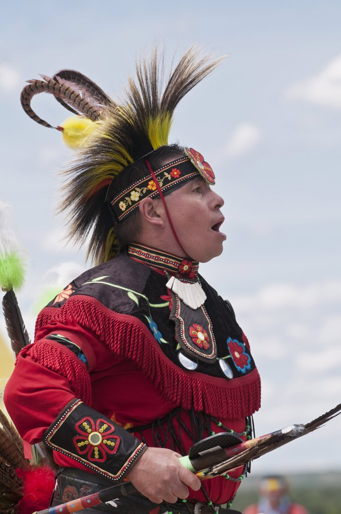 Stock Photo: 4215-325 Male dancer in traditional regalia in 2nd Annual World Chicken Dance Championships, Blackfoot Crossing Historical Park, Alberta, Canada